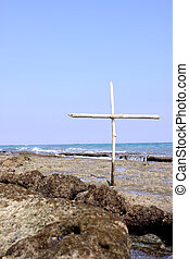 Ocean Memorial - A small wooden cross on a reef, for use in...