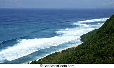 Ocean near green mountain