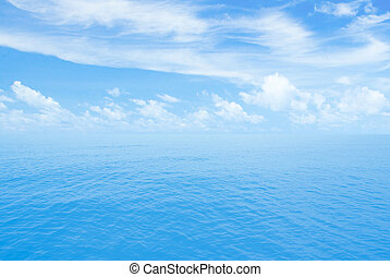 Ocean or sea calm water. Horizon line with partly cloud sky.