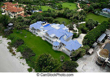 Aerial photograph taken during a flyover of an oceanfront home.