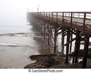 ocean pier and fog