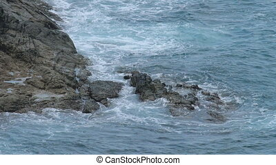 Ocean rocky shore waves - Waves breaking near a rocky shore