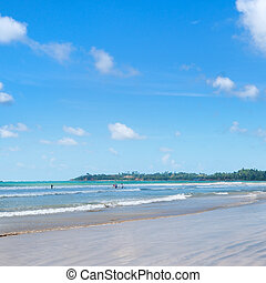 ocean, sandy beach, waves for surfing lessons