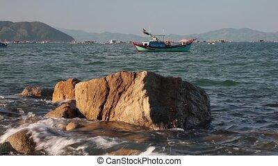 Ocean Scene With Sound Vietnam - A rocky coastline fishing...