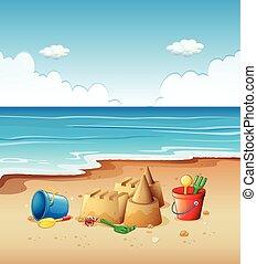Ocean scene with toys on the beach