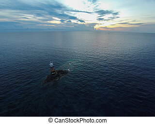 Ocean sea sunset view and lighthouse. Gulf of Thailand sea, Thailand, Wide angle view.