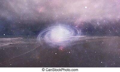 Spinning galaxy over ocean shore