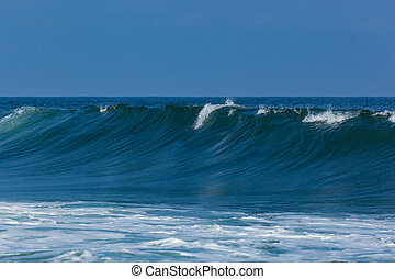 Ocean Spray and Waves - Beautiful waves roll and crash along...