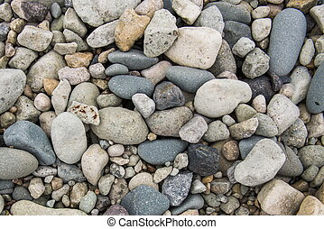 Ocean stones, sand background