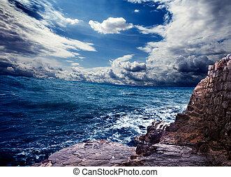 Ocean storm and rocks