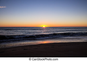 Ocean Sunrise - A sunrise at the ocean with the sun at the...