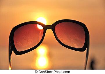 Ocean sunset through the sunglasses