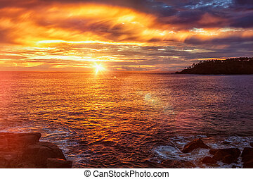 Ocean sunset with dramatic sky