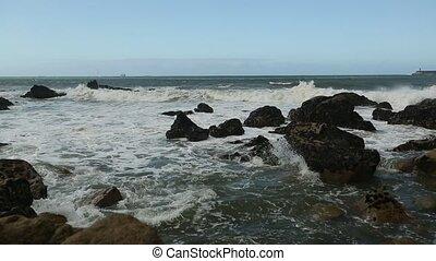Ocean surf, blue sky and splash ove