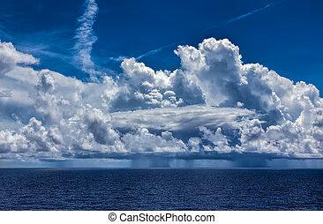 Ocean Thunderstorm with Cumulonimbus Clouds and Rain