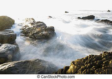Ocean Tide Flowing Over Rocks