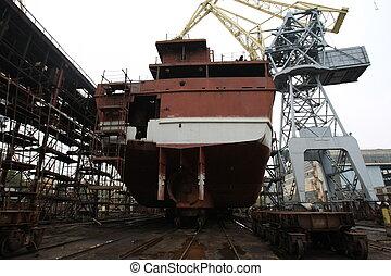 Ocean vessel under repair process in dry dock