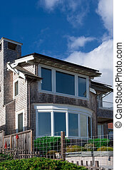 Ocean View - A coastal California home with large windows...