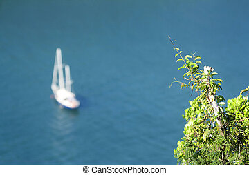 Ocean views on the top of the mountain with sailing boat in the sea