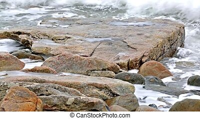 Ocean washing ashore on Maine coast