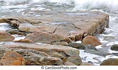 Ocean washing ashore on Maine coast