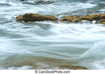 Ocean water rushing over reef