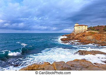 Ocean wave and rocks. Boccale castle landmark. Tuscany,...