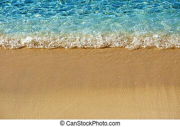 Ocean wave breaking on beach