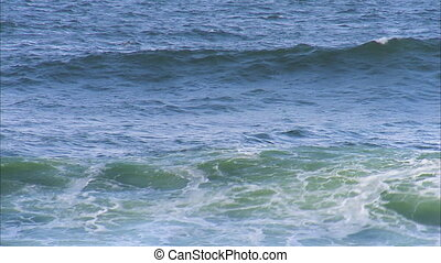 Ocean wave crashing - A steady shot of the ocean's wave as...