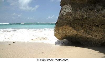 Ocean wave crashing coastline cliff