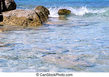 ocean waves and rock