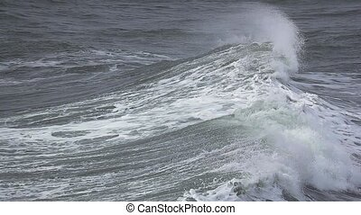 Ocean waves breaking - Huge waves of the ocean breaking,...