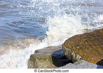 Ocean waves breaking on rocky shore