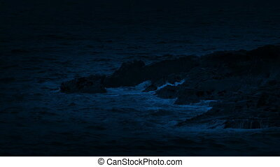 Ocean Waves Breaking On The Rocks At Night