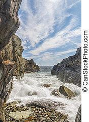 Ocean waves crashing against a rocky shore