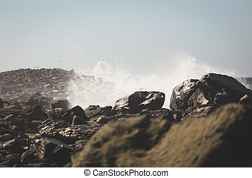 Ocean Waves Crashing into Rocky Shore