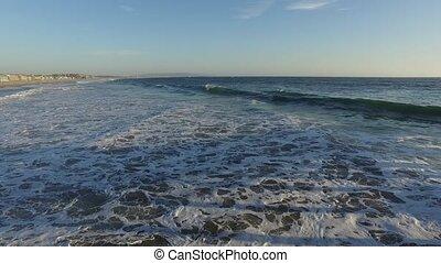 Ocean waves crashing. Marina del Rey, California during sunset