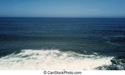 Ocean waves crashing on beach