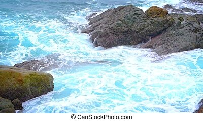 Ocean Waves Crashing over Boulders with Sound