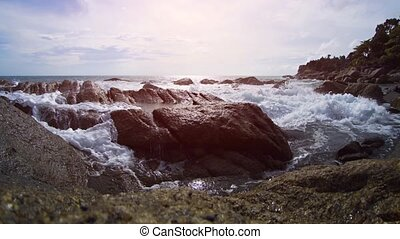 Ocean Waves Filling a Tide Pool in Phuket, Thailand, with...