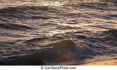 Ocean waves on the sand beach