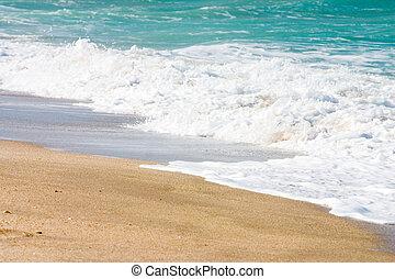 Ocean Waves - Ocean waves washing up on sandy Florida beach