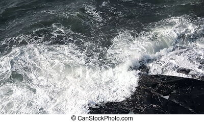 waves touching stone at stormy day - ocean waves touching...