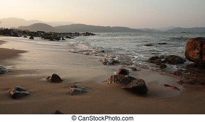 Ocean Waves Vietnam - A coastline scene at sunset looking...