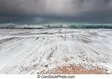 ocean waveson sand beach during storm, Etretat, France