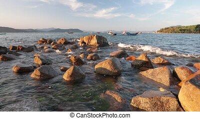Ocean With Sound Vietnam - A rocky coastline fishing port...