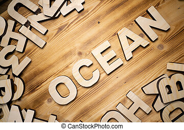 OCEAN word made with block letters lying on wooden board