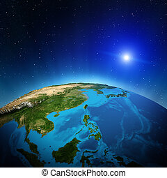Oceania and South-East Asia from space. Elements of this image furnished by NASA