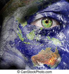 Oceania painted on face with green eye to promote a better...