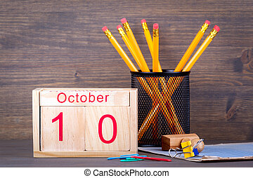 October 10. close-up wooden calendar. Time planning and business background